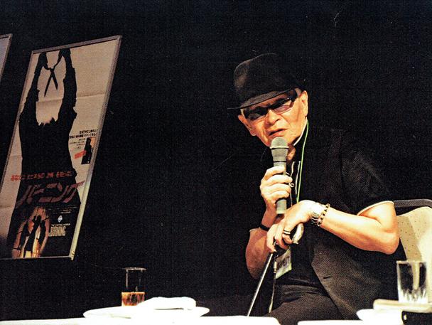 著者。カナザワ映画祭2012のトークショーにて